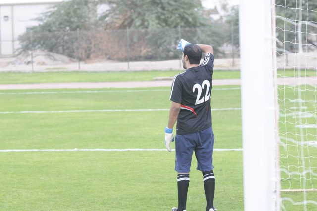 Goalie, Majed Al Rashidi, wipes sweat from his forehead during Saturday's soccer game at Camp Tahreer, Kuwait.  Al Rashidi's and his Kuwaiti team members shutout the 1st TSC by the final score of 7-0.