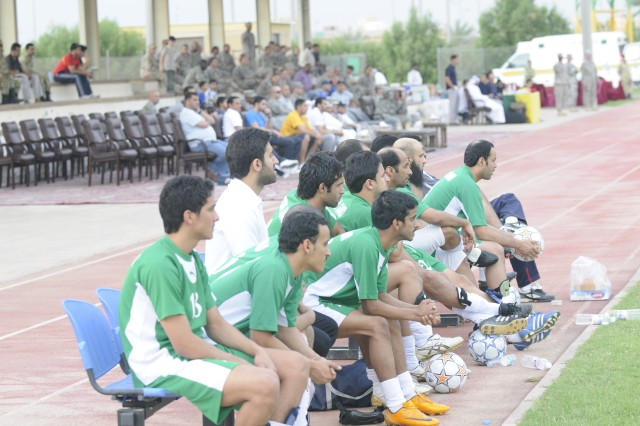 Kuwaiti team members look on from the sidelines as their team defeated the 1st TSC by the score of 7-0 Saturday afternoon at Camp Tahreer, Kuwait.