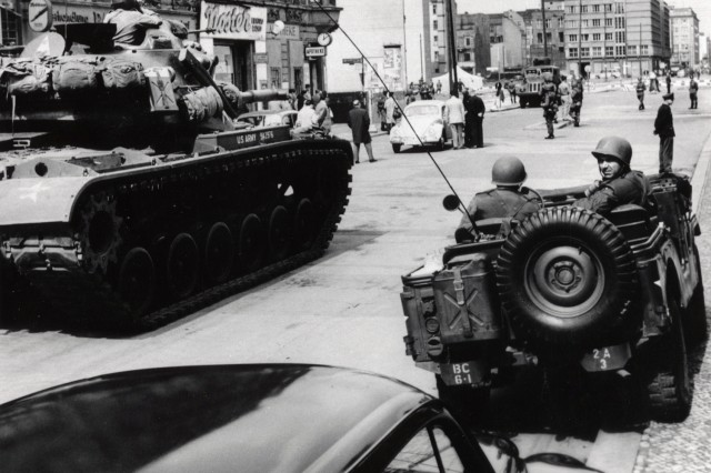 Soldiers from the U.S. Army Berlin Command face off against police from the former East Germany during one of several standoffs at Checkpoint Charlie in 1961. On several occasions that year, a U.S. quick reaction force of tanks and infantry Soldiers stood watch as armed military policemen escorted U.S. personnel across the border into East Berlin.