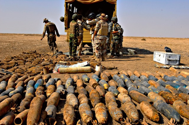 A sea of mortar rounds wait to be wired for explosion by the 704th Explosive Ordinance Disposal Team at the Besmiyah Range Complex, just outside of Baghdad, Iraq, Oct. 26.