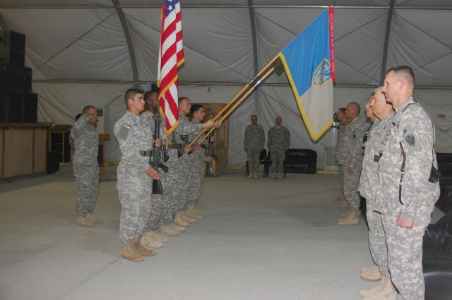 Commanders and Command Sergeants Major from the 504th Battlefield Surveillance Brigade, Fort Hood, Texas, and the 201st BfSB, Fort Lewis, Wash., stand in front of their colors in a transfer of authority ceremony Oct. 28, at Contingency Operating Base Adder. The 201st BfSB will assume command of intelligence, surveillance and reconnaissance missions in Iraq.