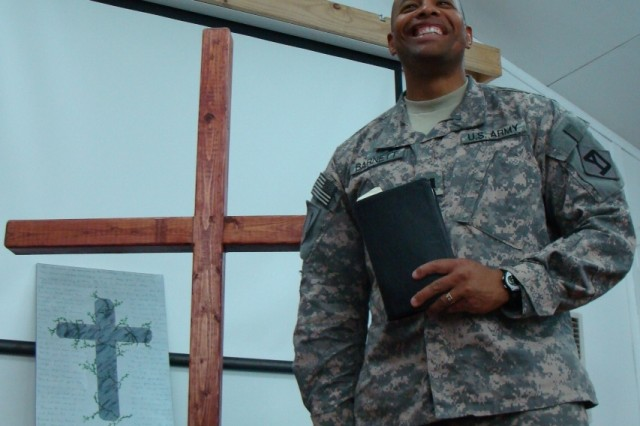 Chaplain (Capt.) Paul Barnett, of Wareham Mass., 101st Engineer Battalion, 225th Engineer Brigade begins choir practice with words of encouragement, Oct.29, on Victory Base Complex, here.