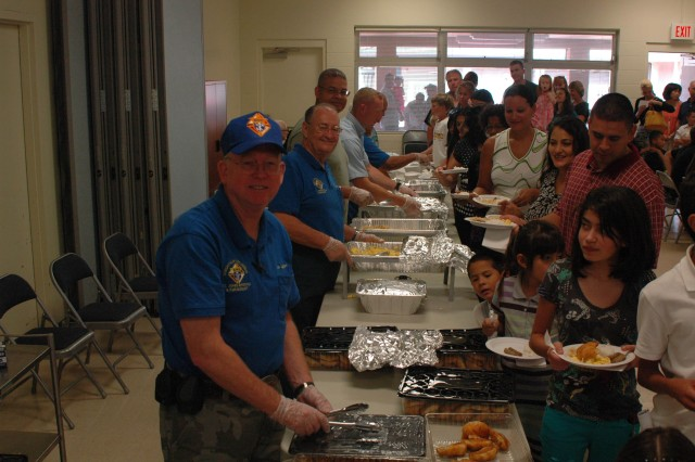 SCHOFIELD BARRACKS, Hawaii - Members of the Knights of Columbus serve breakfast to the crowd after Mass during the 4th Annual Soldier Appreciation Breakfast, at the Main Post Chapel Annex, here, Oct. 25.