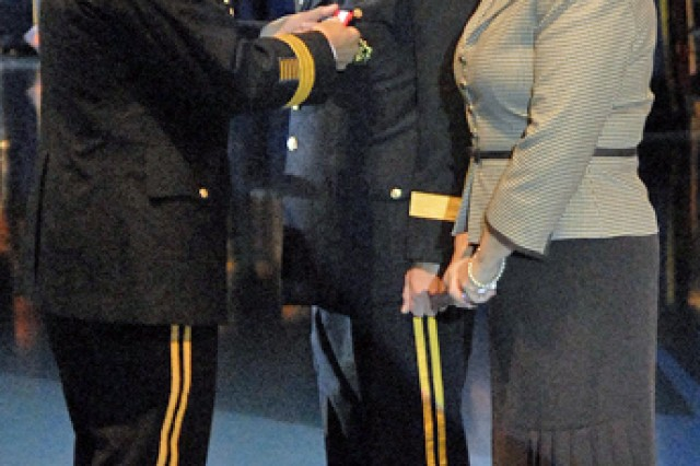 Gen. George W. Casey Jr., Army chief of staff, pins the Distinguished Service Medal on Lt. Gen. Robert Wilson during his retirement ceremony at Conmy Hall on Fort Myer, Va., Nov. 2.