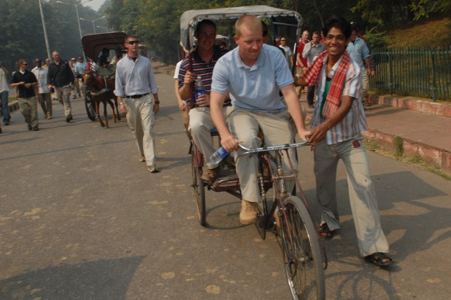 """AGRA, India- (Nov. 1, 2009)- Staff Sgt. Thomas Rinehart, Troop B, 2nd Squadron, 14th Cavalry Regiment """"Strykehorse,"""" 2nd Stryker Brigade Combat Team, 25th Infantry Division, from Schofield Barracks, Hawaii, tries bicycling fellow Soldiers to the Taj Mahal.  U.S. Soldiers were able to visit the palace on their way home from Exercise Yudh Abyas 09, a bilateral field-training exercise involving the Armies of India and the United States. (Photo by Staff Sgt. Crista Yazzie, U.S. Army, Pacific Public Affairs)"""