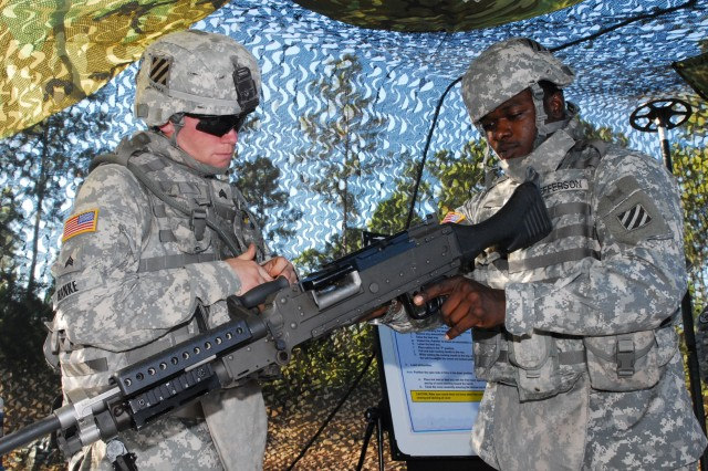 Specialist Larry Jefferson clears an M240B machine gun as part of the Patriot Challenge, Oct. 29.
