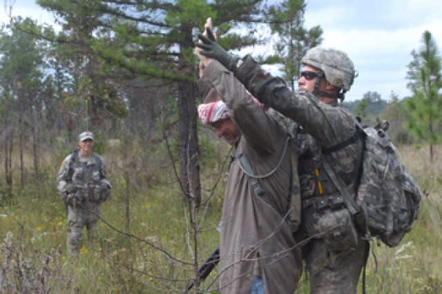 Spc. David Loremayo, Troop B, 3rd Squadron, 89th Cavalry Regiment, 4th Infantry Brigade Combat Team, 10th Mountain Division, secures a disarmed person of interest during a squadron field training exercise at Castor 1 and 2 training areas, Sept. 23.