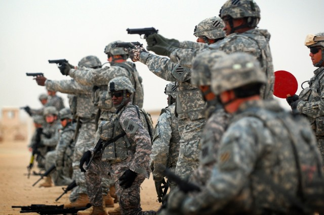 Several days into their 12-month tour, Soldiers from 2nd HBCT test their weapons  at Camp Buehring's firing range in Kuwait before leaving for Mosul, Iraq, Oct 31.