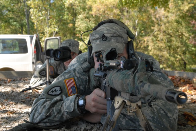 Spotter Sgt. 1st Class Timothy Johns and shooter Staff Sgt. Kevin Wildman took first place in the open class division at the International Sniper Competition. Johns and Wildman are assigned to 2/46 Infantry, 194th Armored Brigade at Fort Knox, Ky.