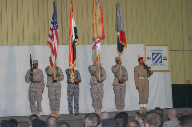 Multi-National Division - North color guard stands at attention as Task Force Marne Commander Maj. Gen. Tony Cucolo assumes command during a ceremony held at Contingency Operating Base Speicher, Iraq, Nov. 3.