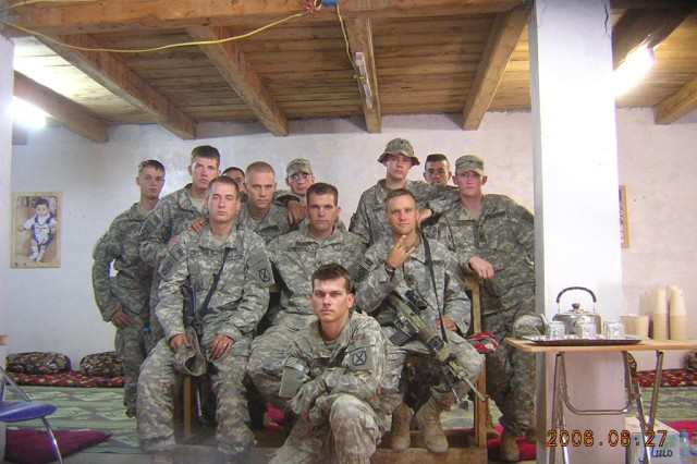 Staff Sgt. John Hawes, far left, poses with the other surviving members of a reconnaissance patrol that was ambushed June 21, 2006 in Afghanistan. Among those killed in the battle was Sgt. 1st Class Jared Monti, who was posthumously awarded the Medal of Honor for his actions during the fight.