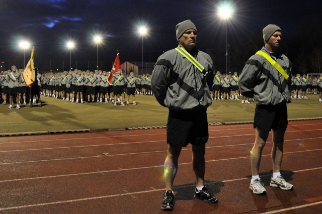 """Sgt. Maj. of the Army Kenneth O. Preston, Command Sgt. Maj. Ralph Beam and Bamberg Soldiers await reveille before starting a 3-mile run on Warner Barracks on Nov. 5."""""""