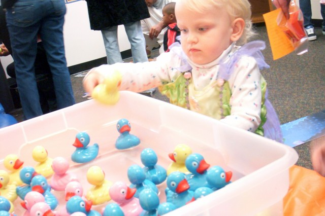 Hannah Smith, 2, daughter of Kylee and Spc. Will Smith, driver for U.S. Army Garrison Commander Deborah B. Grays, bobs for ducks.