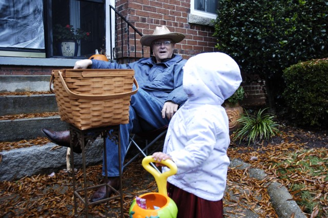 Col. Leo Tucker, surgeon, First Army, gets surprised by Carla Graniela, 2, while trick-or-treating Saturday on Fort McPherson. Graniela is the daughter of Annell Graniela, Clayton County juvenile court supervisor, and was one of many children walking the streets in search of candy.
