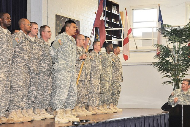 Lt. Col. Cephus Roupe, commander, 1st Medical Brigade (Provisional), Fort Hood, Texas, addresses Soldiers of the 418th Medical Logistics Company Nov. 3 during a deployment ceremony at the Army Community Service Center. More than 80 Soldiers are deploying to Iraqi for 12 months in support of Operation Iraqi Freedom.