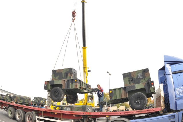 Contractors load 1st Armored Division's equipment at the Installation Staging Area on Wiesbaden Army Airfield in preparation for shipment to Iraq. The division is slated to deploy early next year.