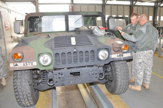 Sgt. Michael Garcia, 501st Military Police Company, helps check documentation at one of the stations during the 1st Armored Division's Installation Staging Area on Wiesbaden Army Airfield.