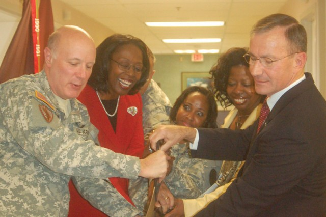 Brig. Gen. W. Bryan Gamble,commanding general of Dwight David Eisenhower Army Medical Center and the Southeastern Regional Medical Command, staff members, and Retired Brig. Gen. Donald Bradshaw, cut the ribbon on the new in-patient treatment facility at DDEAMC.