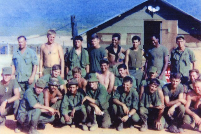 Tom Dosier, front left, poses with his platoon in Vietnam, January 1969. Dosier, 20 at the time, was the second oldest person in this photo.