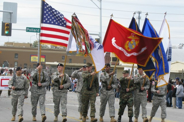 The Redstone Arsenal Color Guard marches in the 2008 Veterans Day Parade. The color guard will once again lead off the parade Nov. 11 through downtown Huntsville. The military personnel who participate in the parade are most popular among spectators.