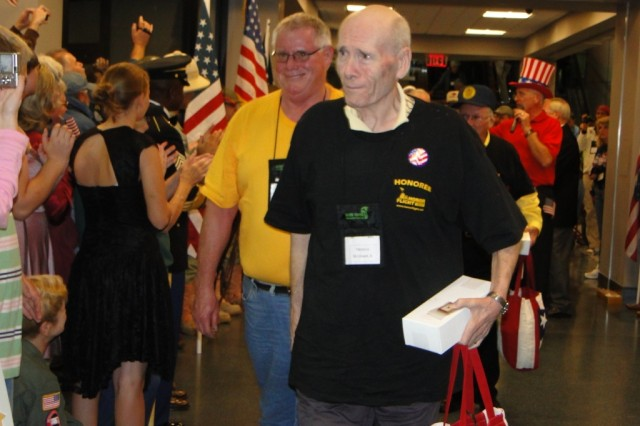 """Retired Air Force Col. (Dr.) Tom McCrickard is brought to tears by the outpouring of support and love that greeted WW II veterans upon their return to Huntsville International Airport after an """"awe-inspiring"""" day visiting their memorial in Washington, D.C."""