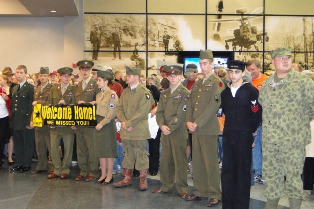 JROTC re-enactors from Columbia High School and North Carolina's West Harnett High School wear WW II uniforms in honor of Honor Flight's passengers. They lined up along the walkway at Huntsville International Airport to welcome WW II veterans home from their Honor Flight.