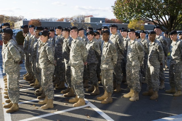 Soldiers from U.S. Army Research Institutitute of Enviornmental Medicine pause for a moment of silence in memory of those lost and injured at Fort Hood.