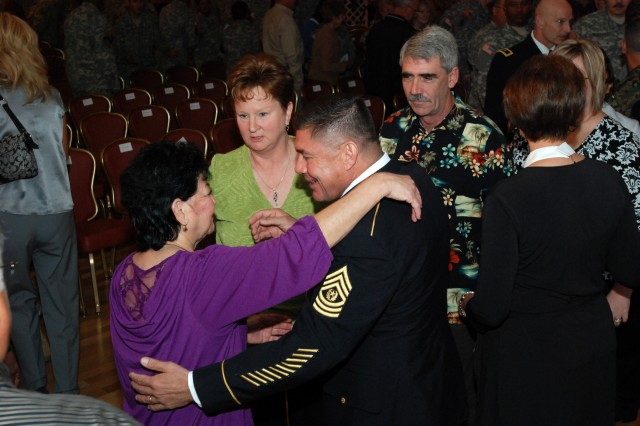 Command Sgt. Maj. Armando Ramirez, U.S. Army South command sergeant major, visits with family members after his retirement ceremony at the Fort Sam Houston Club Nov. 5. (Photo by Robert R. Ramon, U.S. Army South Public Affairs Office)