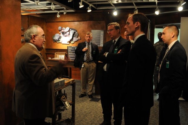 Barry Gangi, AMC's office of Public and Congressional Affairs, provides an Army technology brief to Congressional staffers from the Utah delegation during their visit to AMC headquarters Nov. 6. Photo by Wayne Scanlon.