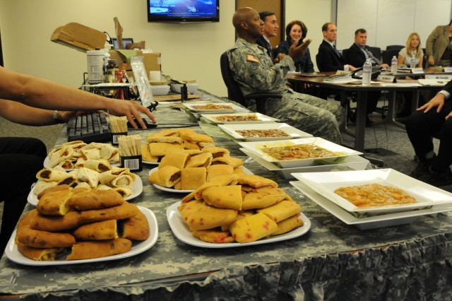 The DoD Combat Feeding Directorate located in Natick, Mass., set up a display at AMC headquarters for Congressional staffers from the Utah delegation Nov. 6. The exhibits included operational rations such as the Meal, Ready to Eat™, First Strike Ration®, the Unitized Group Ration-Express™, and the Modular Operational Ration Enhancement.  Photo by Wayne Scanlon.