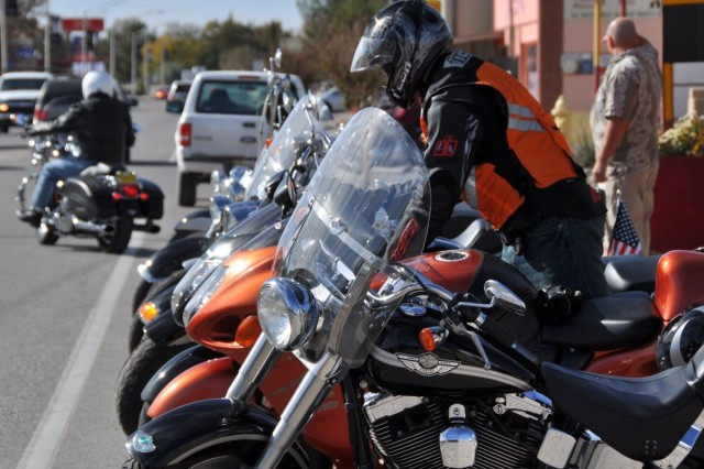 """After donning his personal protective equipment, Capt. Thomas Shippee prepares his Suzuki Hayabusa to depart the Pepper Pot Restaurant in Hatch, New Mexico where the safety ride stopped for lunch."""""""