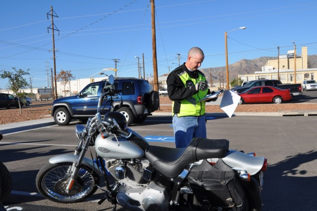 """Capt. Ramon Johnson inspects a soft tail Harley Davidson before the ride. The pre-ride checklist is to ensure all the motorcycles and documentation are current and safe."""""""