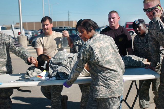First responders use a table as a stretcher to transport a wounded Soldier to an awaiting ambulance at Fort Hood, Texas, Nov. 5.