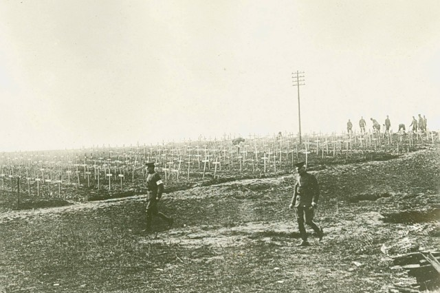 American Heroes at Rest.  Senior leaders inspecting a temporary cemetery where soldiers from the 27th and 30th Divisions rest. (WWI Signal Corps Collection).