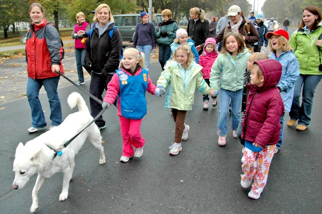 Wiesbaden Girl Scouts from Daisy Troop 86 take part in the Autism Awareness Walk. More than 80 people turned out of the walk in Wiesbaden's Hainerberg Housing Oct. 24.