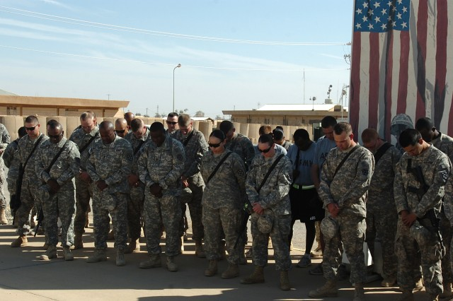 CONTINGENCY OPERATING LOCATION Q-WEST, Iraq - Members of Fort Hood-based 15th Sustainment Brigade observe a moment of silence in front of the brigade headquarters here, Nov. 8, for those that were killed and wounded in the shooting at Fort Hood, Texas, Nov. 5.