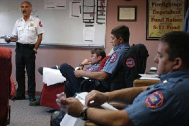 Capt. Brian Van Pelt, Capt. Michael Goins and Jeremy Parker listen as Chief Michael Kuk, Fort Polk Fire Department, explains department policies during a meeting Oct. 20.