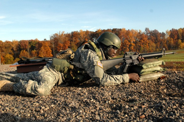 Pvt. Daniel Monibe prepared to fire his weapon during the units Basic Rifleman Marksmanship training.