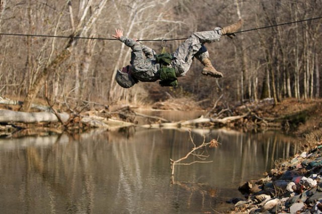 A Texas A&M Cadet crosses a stream on a one-rope bridge during the Bold Leader Challenge hosted by U.S. Army Cadet COmmand 1st Brigade at Fort Knox.""
