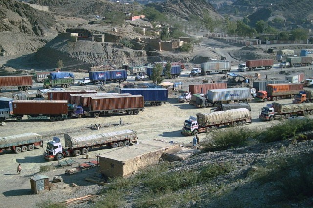 The Surface Deployment and Distribution Command at Scott oversees the movement of military goods between Pakistan and Afghanistan; here, commercial trucks wait to cross Torkham Border Crossing into Afghanistan. Surface Deployment and Distribution Command at Scott Air Force Base.