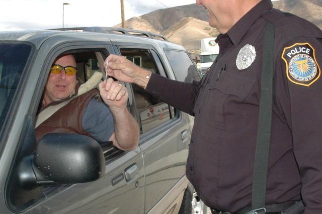 Security Officer John C. Hunt, checks Roben Palmer's badge as he enters the depot.