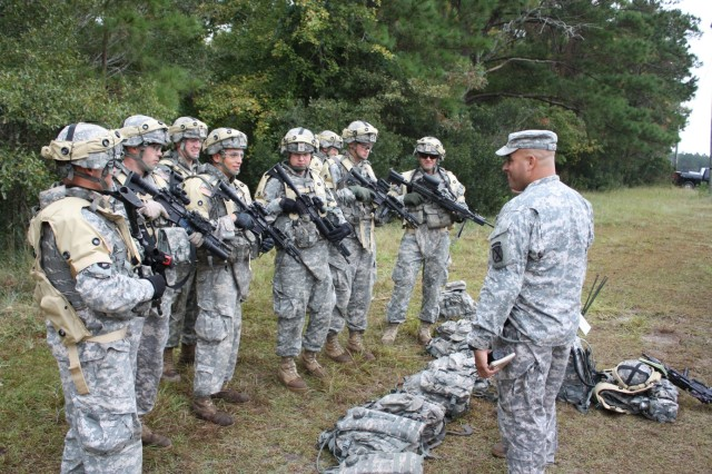 Soldiers from the 4th Brigade Combat Team, 10th Mountain Division, Fort Polk, La., practice using new advanced combat identification equipment during the Bold Quest exercise at Camp Lejeune, N.C.
