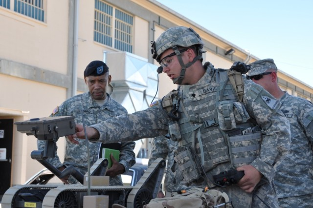 Spc. Kelvin Davis explains the different cameras and audio equipment on the SUG-V and how the soldier can use the system to remain at a safe distance from potential hazards.