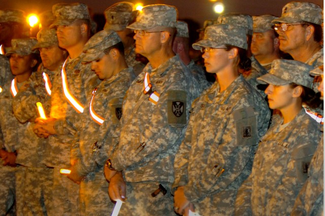 Soldiers attend a chemical light vigil held at the North Fort Hood training site Nov. 6, 2009, in remembrance of comrades and loved ones who were killed and wounded in the shooting tragedy at Fort Hood, Texas, the previous afternoon.