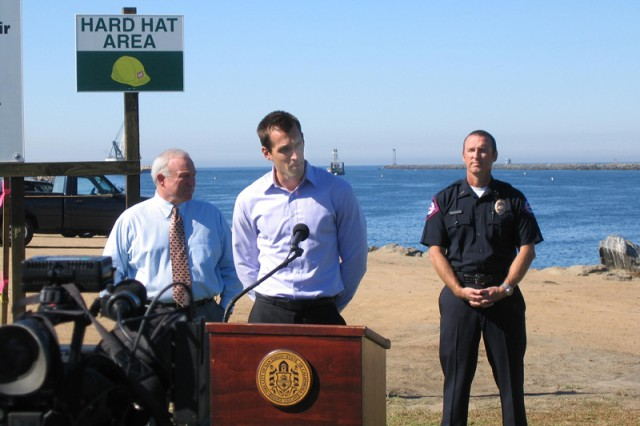Scott John, project manager for Mission Bay jetty repairs, answers media questions while flanked by San Diego Mayor Jerry Sanders (left) and Lt. Rick Wurts, spokesman for San Diego County Lifeguard Service. (USACE photo by Greg Fuderer)