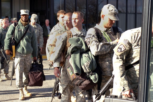 INDIANAPOLIS, Ind. - Army Reserve Soldiers from the 351st Ordnance Company prepare to board a bus back to Camp Atterbury after returning from a 10-month deployment in Iraq.