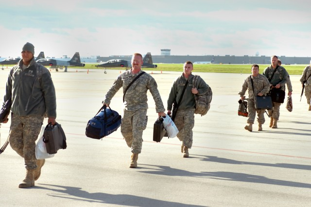 INDIANAPOLIS, Ind. - Army Reserve Soldiers from the 351st Ordnance Company walk across the tarmac after returning from a 10-month deployment to Iraq.