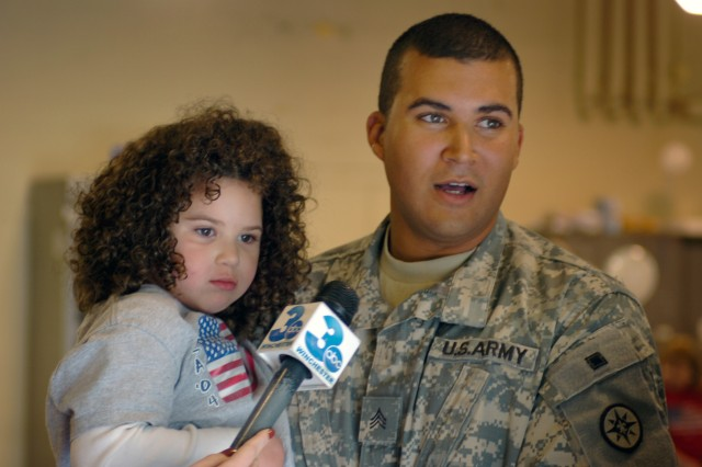MARTINSBURG, W.V. - A Soldier from the 351st Ordnance Company, 2nd platoon holds his daughter at the United States Army Reserve Center here Thursday after a returning from a 10-month deployment in Iraq.