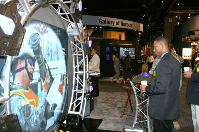Darien Hawkins of the Joint Training Counter-IED Integration Center, Newport News, Va., watches a vignette at the ASC booth during the annual AUSA meeting in Washington, D.C., Oct. 5-7.