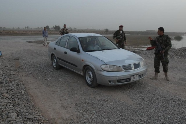 Iraqi Security Forces stop a vehicle at a checkpoint near Shariyah, Iraq, Nov. 4 in order to search it. The U.S. Army conducts regular training with the ISF manning these checkpoints.